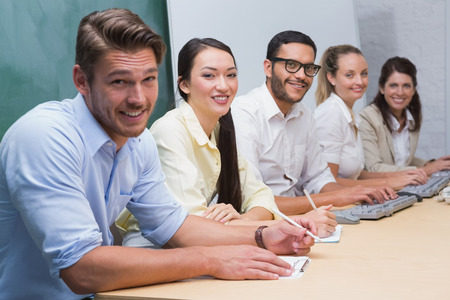 Five person Business team looking at camera and smiling in the office photo