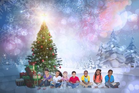 Composite image of cute children smiling at camera against snowy landscape with fir trees photo