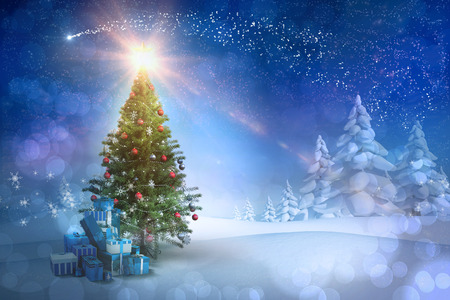 Composite image of christmas tree with gifts against snowy landscape with fir trees Stockfoto