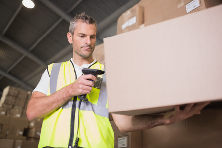 Manual worker scanning package in the warehouse photo