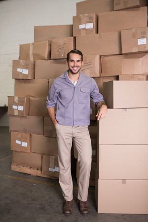 Portrait of manual worker standing in the warehouse photo