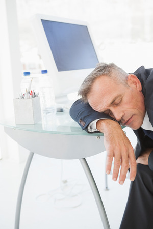 passed out: A passed out businessman in his office asleep on the desk Stock Photo