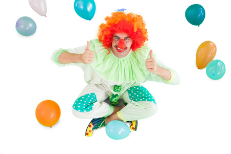 Funny clown smiling at camera on white background photo
