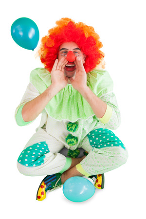 Funny clown shouting at camera on white background photo