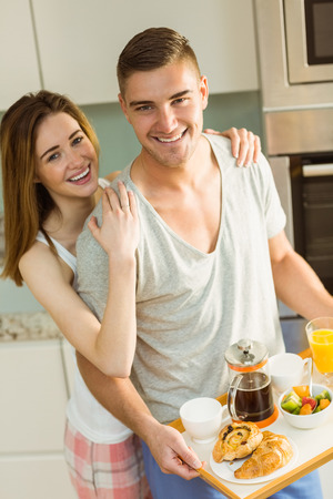 Cute couple preparing their breakfast at home in the kitchen photo