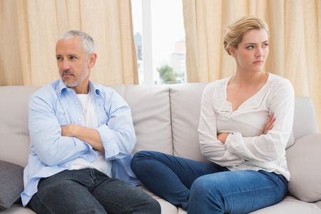 human relationship: Couple not talking after a dispute on the sofa at home in the living room