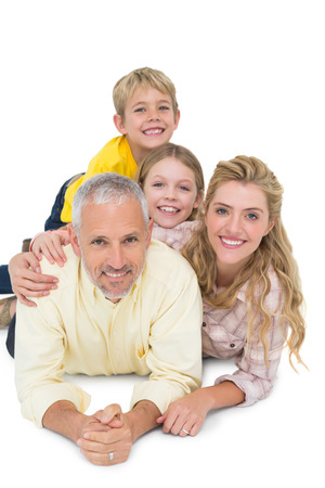 female portrait: Happy family lying and smiling on white background