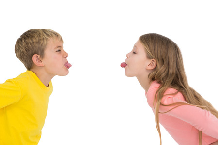 Cute siblings teasing each other on white background Stock Photo