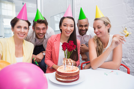 birthday adult: Casual business team celebrating a birthday in the office