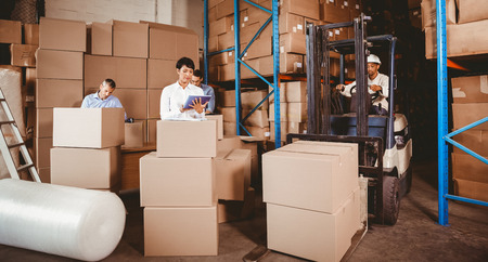 Warehouse team working during busy period photo