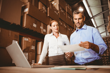 colleague: Warehouse manager talking with colleague