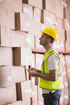 Warehoue worker using digital tablet in warehouse photo