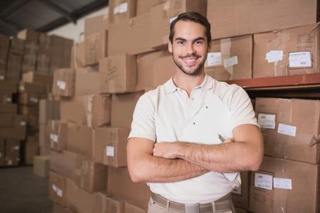 Portrait of a confident worker smiling in the warehouse photo