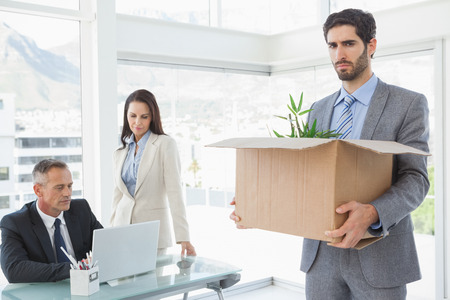 Unhappy employee being let go from work Stock Photo