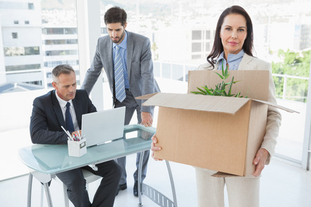 Unhappy businesswoman being let go from the business photo