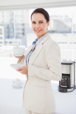 warm drink: Businesswoman enjoying her break time with a nice warm drink