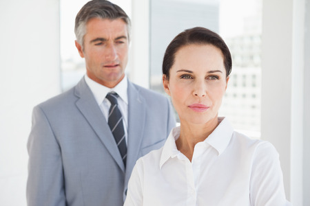 Concentrated businesswoman looking away from co worker photo