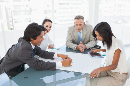 Business team having a meeting and looking at plans Stock Photo