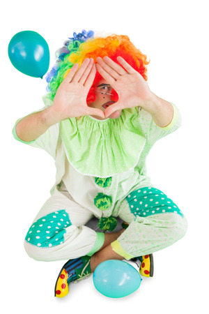 Funny clown framing with hands on white background photo