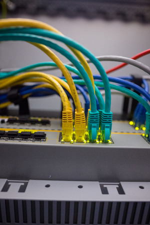 plugged in': Close up of USB wires plugged in a server