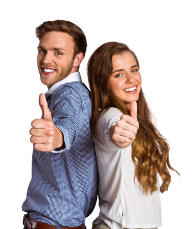 back up: Portrait of happy young couple gesturing thumbs up over white background Stock Photo