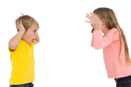 Cute siblings teasing each other on white background photo