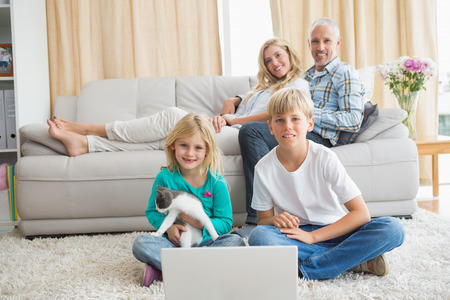 Happy family spending time together at home in the living room photo