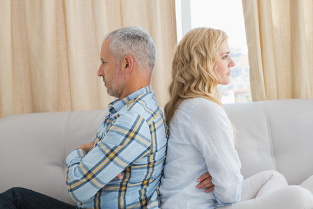 Couple arguing on the couch at home in the living room