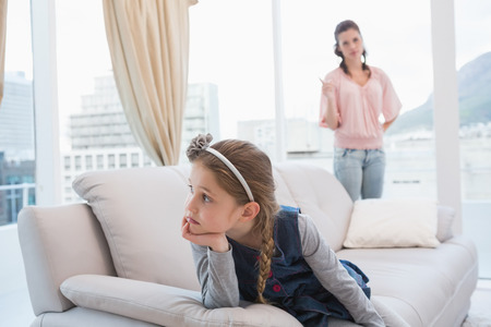 reprimanding: Mother and daughter not talking after argument at home in the living room