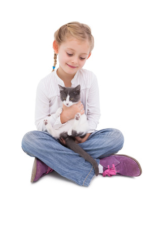 Little girl sitting with cat in her arms on white background Stock Photo