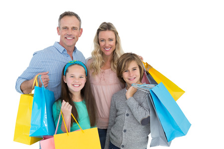 Portrait of smiling family with shopping bag on white background photo