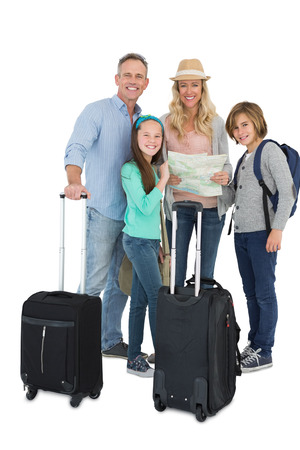 Tourist family consulting the map on white background photo