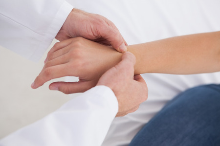 carpel: Doctor examining patients wrist in his office