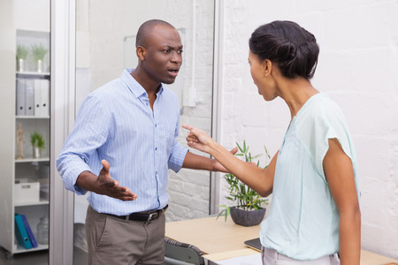 Casual business partners having an argument in the office