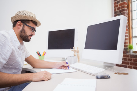 Casual designer drawing at his desk in the office photo