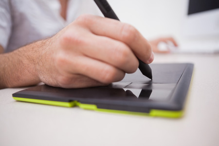 graphics tablet: Designer using graphics tablet and colour wheel in the office
