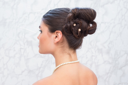 hair do: Pretty brunette with stylish up do at the hair salon