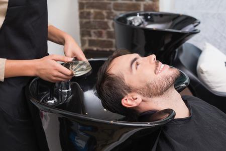 hair stylist: Hair stylist washing mans hair at the hair salon
