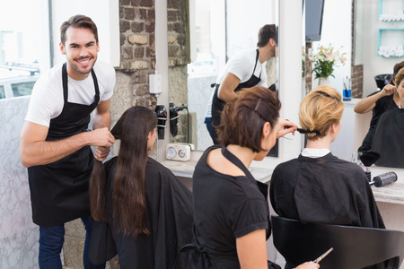 Hairdressers working on their clients at the hair salon photo