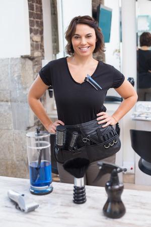 hair stylist: Hair stylist smiling at camera at the hair salon