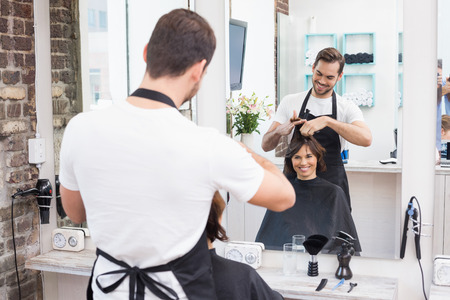 hair stylist: Handsome hair stylist with client at the hair salon Stock Photo