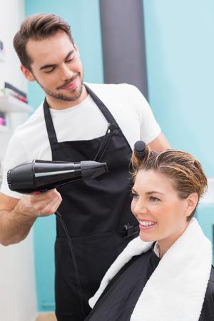 Woman getting her hair dried at the hair salon photo