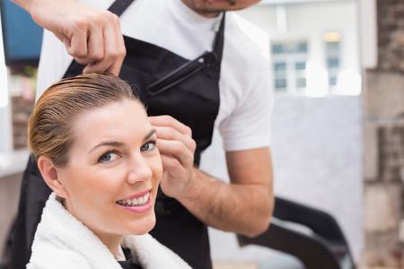 hair stylist: Pretty woman with her hair stylist at the hair salon