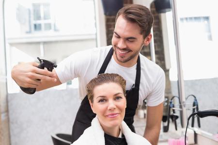 hair stylist: Handsome hair stylist with client at the hair salon Stock Photo