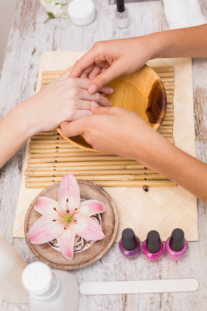 soaking: Nail technician giving customer a manicure at the beauty salon Stock Photo
