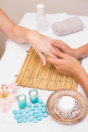 Woman getting a hand massage at the beauty salon photo