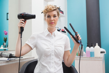 Customer holding a hairdryer and styler photo