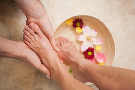 feet in water: Pedicurist washing a customers feet at a salon Stock Photo