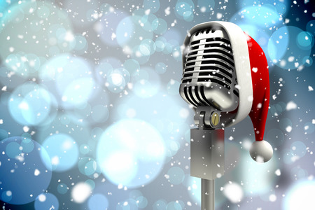 Composite image of microphone with santa hat against light glowing dots design pattern photo