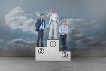 Composite image of business people on podium against clouds in a room photo